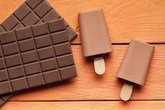 Lollies льда и бар шоколада Стоковые Изображения