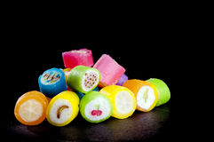 Lollies. In different colors with fruit symbols over black in shallow focus Stock Images