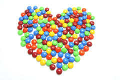 Lollies in Heart Shape. Chocolate Lollies Arranged in Heart Shape on White Background Stock Photo