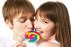 Lollipop. A young teenage couple shares a lollipop Royalty Free Stock Photography