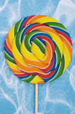 Lollipop. Colourful lollipop on a blue and white background stock image