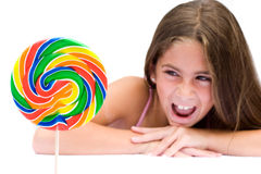 The Lollipop. Young girl looking at her fun lolipop Royalty Free Stock Image