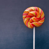 Lollipop on blackboard background joyful childhood Royalty Free Stock Photo