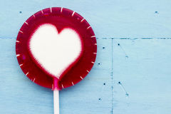 Lollipop on blue Royalty Free Stock Photos