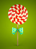 Lollipop with bow on green background Royalty Free Stock Images