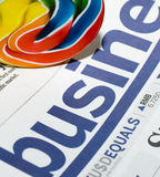 Lollipop on a business newspaper Royalty Free Stock Photo