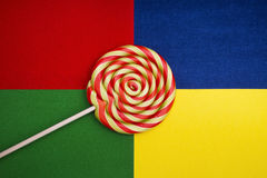 Lollipop candy. Beautiful lollipop candy on colorful background Stock Photography