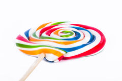 Lollipop Candy on Stick. Colorful spiral lollipop candy on stick, isolated on white background stock photos