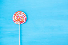 Lollipop candy on a turquoise background Stock Image