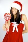 Lollipop for christmas hold by female santa claus Stock Image