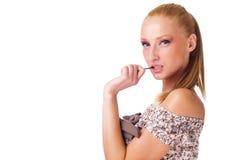 Lollipop della holding della donna abbastanza giovane Immagini Stock Libere da Diritti