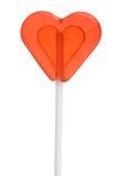 Lollipop di figura del cuore su un bastone Fotografia Stock