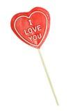 Lollipop en forma de corazón en el fondo blanco imagen de archivo libre de regalías