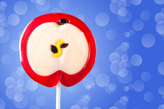 Lollipop in the form of an apple Stock Photo