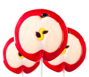 Lollipop form of an apple Stock Photos