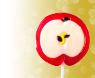 Lollipop in the form of an apple Stock Photos