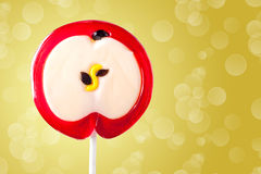 Lollipop in the form of an apple Royalty Free Stock Photo