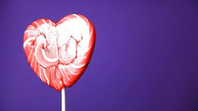 Lollipop in the form of an heart stock footage