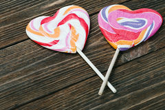 Lollipop in form of heart on the table Stock Photos