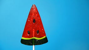 Lollipop in the form of an watermelon stock video