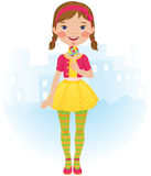 Lollipop girl. The little girl in a beautiful dress with a lollipop in his hand Royalty Free Stock Images