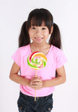 Lollipop girl. Beautiful little girl with lollipop Stock Image