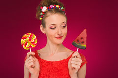 Lollipop. Girl with sweet candy in their hands. Stock Photo