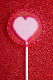 Lollipop on glitter Royalty Free Stock Images