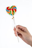 Lollipop with hand. Lollipop with asian hand isolated Royalty Free Stock Photography