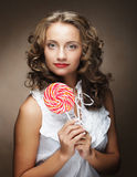 Lollipop in hand. Beautiful  girl with  candy. Stock Images