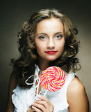 Lollipop in hand. Beautiful  girl with  candy. Stock Photography