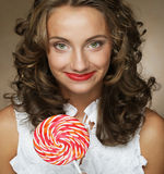 Lollipop in hand. Beautiful  girl with  candy. Royalty Free Stock Image