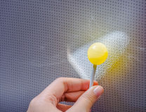 Lollipop in hand Stock Images