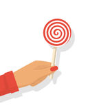 Lollipop in hand vector. Lollipop in hand. Female hold striped candy. Vector illustration flat design. Isolated on white background. Candy on a wooden stick Royalty Free Stock Images