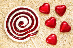 Lollipop and heart candies on straw Royalty Free Stock Image