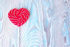 Lollipop heart on vintage blue wooden background. Empty space for your text. Valentine day postcard Royalty Free Stock Photos