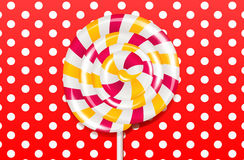 Lollipop. An illustration of a lollipop on a red polka dot background Royalty Free Stock Photo