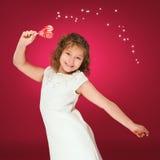 Lollipop La muchacha con un caramelo amor-formado Fotografía de archivo libre de regalías