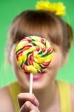 Lollipop in mano della ragazza Immagine Stock Libera da Diritti