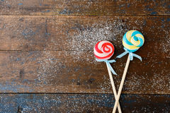 Lollipop on a old wooden background Stock Images
