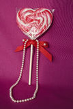 Lollipop and pearls for a Romantic Gift Royalty Free Stock Images
