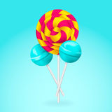 Lollipop. Pink and yellow spiral candy. Stock Photos