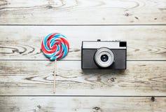 Lollipop and retro camera Royalty Free Stock Photos