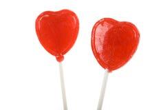 Lollipop rojo de la dimensión de una variable del corazón Imágenes de archivo libres de regalías