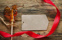 Lollipop, rooster, red satin ribbon Stock Image