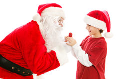 Lollipop From Santa Claus. Santa Claus gives a Christmas lollipop to a cute little boy. Isolated on white stock photos