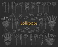 Lollipop set vector hand drawn doodle illustration. Different types of sweets, candies, lollipops, sweetmeats, glass candy jars, isolated on chalkboard Stock Photography