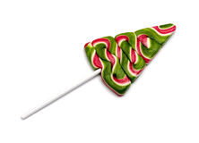 Lollipop in the shape of Christmas tree. On white background Royalty Free Stock Photos