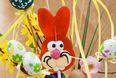 Lollipop-shaped Easter Bunny with eggs Stock Photo