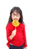 Lollipop smile. Asian little girl smile with colorful lollipop isolated on white background royalty free stock images